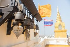 Thailand, decoration, flag, nobody, hanging, river, ornament, brown, sound, yellow, landmark, attraction, bright, ring, buddhist,. The bell with message on it on Stock Photos