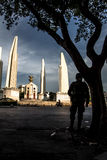 Thailand Democracy Monument with soldier silhouette. Sunset Royalty Free Stock Photography