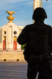 Thailand Democracy Monument with soldier silhouette. Sunset Stock Photos