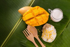 thailand dessert by sweet mango and sticky rice on banana leaf. Royalty Free Stock Photography