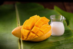 thailand dessert by sweet mango and sticky rice on banana leaf. Royalty Free Stock Images