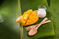 thailand dessert by sweet mango and sticky rice on banana leaf. Stock Photos