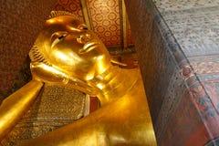 thailand för staty för pho för bangkok buddha framsidaguld reclining wat bangkok phothailand wat Royaltyfri Bild