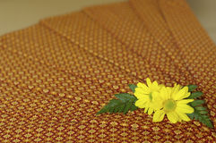 Thailand fabric spa massage with yellow flower Stock Images