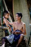 Thailand Father and son are working hand made Basket bamboo or f Stock Images