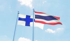 Two waving flags. Thailand and Finland, two flags waving against blue sky. 3d image Stock Image