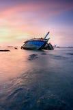 Thailand fisherman's boat. The old fisherman boat damage at sunset Stock Image