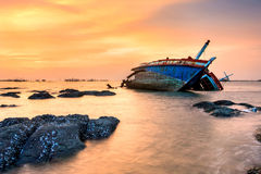 Thailand fisherman's boat. The old fisherman boat damage at sunset stock photography