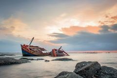 Thailand fisherman's life. Old Fisherman boat at sunset stock photo