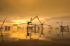 Thailand Fisherwoman at sunrise. Pakpra, Phattalung, Thailand stock image