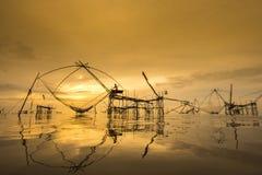 Thailand Fisherwoman at sunrise. Pakpra, Phattalung, Thailand stock photo