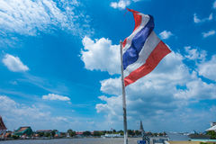 Thailand flag blowing in the wind above the river Royalty Free Stock Photo