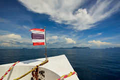 Thailand flag with boat sails to Koh Phi Phi island, Thailand Stock Photos