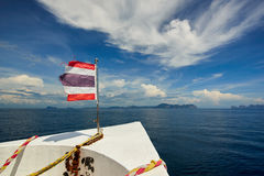 Thailand flag with boat sails to Koh Phi Phi island, Thailand Royalty Free Stock Image