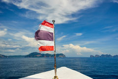 Thailand flag with boat sails to Koh Phi Phi island, Thailand Royalty Free Stock Images
