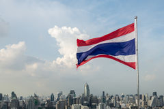 Thailand flag and city view. With sky and clouds Stock Photos