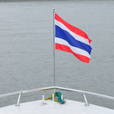 Thailand flag in front of big boat Stock Images