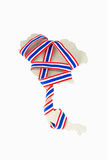 Thailand flag ribbon on map.  stock photography
