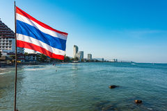 Thailand flag with sea and skyscrapers on the background Royalty Free Stock Photos