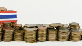 Thailand flag with stack of money coins. Thailand flag waving with stack of money coins stock footage