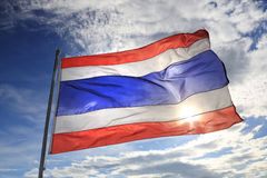Thailand flag waving in the wind with beautiful blue sky and sun Stock Images