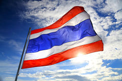 Thailand flag waving in the wind with beautiful blue sky and sun Stock Image