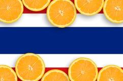 Thailand flagga i citrusfruktskivahorisontalram fotografering för bildbyråer