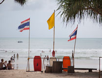 Thailand flags on the background of the sea . Rescue board on sea beach. Thailand flags on the background of the sea royalty free stock photos