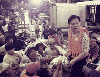 Thailand 2010 flood. Leader of emergency dept. helping people in Donmeung Royalty Free Stock Photo
