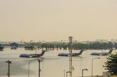 2011 Thailand floods. BANGKOK - November 20, 2011: Many airplanes drown in the water at Don Muang International Airport during the big flooding in Bangkok Stock Images
