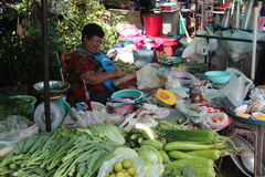 Thailand fresh fruit and vegetable market. Bangkok, Thailand- June 11, 2015:  Fresh fruit and vegetable market in Bangkok. The women sorting the chillies while Royalty Free Stock Photo