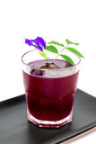 Thailand fresh healthy herbal beverage An-chan juice with lemon juice butterfly pea floweron white background. Thailand fresh healthy herbal beverage An-chan royalty free stock photo