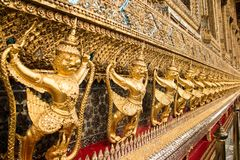 Showing Garuda a national symbol of Thai at the Royal Palace- Details. Thailand. The Grand Palace. Temple of the Emerald Buddha. Gold ornamental patter Royalty Free Stock Photo