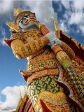 Thailand Guardian Statue. One of the huge, colorful, and imposing guardian statues at the entrance of the Grand Palace in Bangkok, Thailand royalty free stock photos