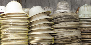 Thailand Hats. Stacks of different type of handmade Thailand hats at the floating market Stock Photos