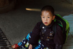 Thailand hill tribe boy sitting on the street Stock Images