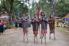 Thailand hill tribe standing on bamboo showing traditional dance Royalty Free Stock Photos