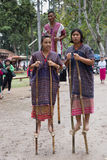 Thailand hill tribe standing on bamboo showing traditional dance Royalty Free Stock Photography