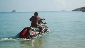 Thailand, Koh Samui 12 december 2015. Man driving a scooter at race on the sea in slow motion. 1920x1080 stock video