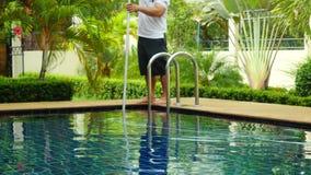 Thailand, Koh Samui, 2 december 2015. Worker man clean a swimming pool in resort. 3840x2160 stock footage