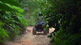 THAILAND, KOH SAMUI - FEBRUARY 25, 2019: Tourists Riding All-Terrain Vehicle also called ATV around Island
