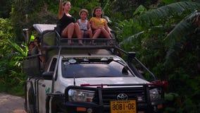 THAILAND, KOH SAMUI - FEBRUARY 25, 2019: Tourists Riding Jeep at Sightseeing Tour around Island