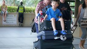 Thailand, Koh Samui, 19 january 2016. Travelers pulling suitcase from airport terminal arrived on Koh Samui in slow. Travelers pulling suitcase from airport stock footage