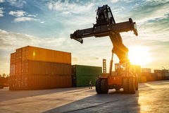 Thailand Laem Chabang Chonburi Industrial logistic forklift truck containers shipping cargo in port at sunset time. stock images