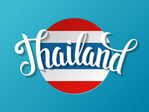 Thailand lettering on the national flag background. Royalty Free Stock Image