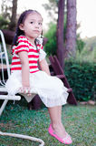 Thailand little girl waiting. Royalty Free Stock Photos
