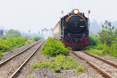 Thailand locomotive trains running on rialroad track use for vin Stock Photos