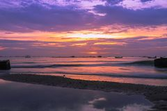 Thailand low tide beach at dusk time. Sunset seascape with beautiful twilight sky royalty free stock photography