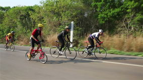 Thailand - March 1: Tracking a cyclist ride bicycle hill climbing Sangkhlaburi, Thailand 2015. stock video