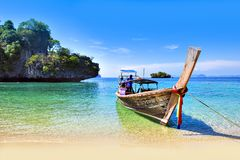 Thailand - May 5, 2016 : Long tail boats wait for tourists at Island, Krabi, Thailand Royalty Free Stock Images